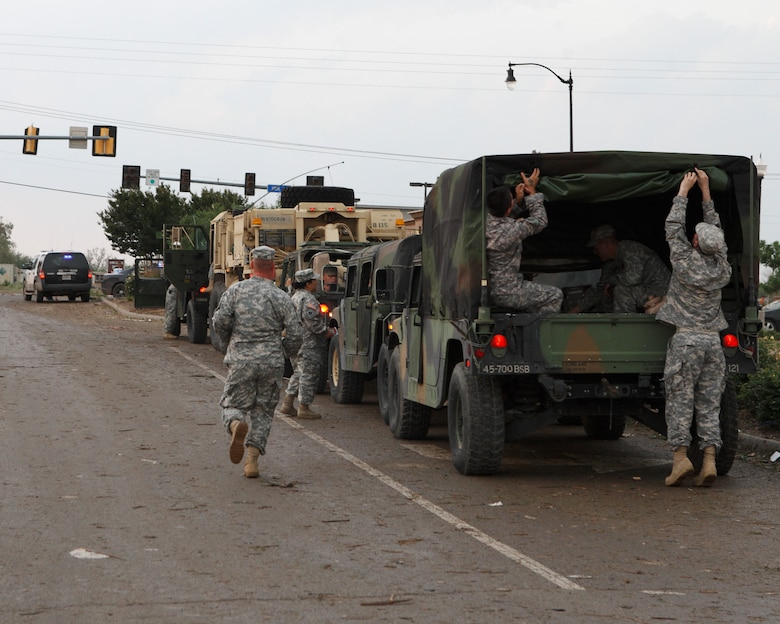 Oklahoma National Guard soldiers and airmen respond to a devastating tornado that ripped through Moore, Okla., May 20, 2013. (Photo by Sgt. 1st Class Kendall James)