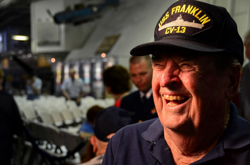 Samuel Rhodes Jr., a World War II veteran, shares a laugh during an interview May 17, 2013, aboard the USS Yorktown (CV 10) at Patriots Point Naval and Maritime Museum. Rhodes, along with approximately 20 remaining crewmembers of the USS Franklin (CV 13) and their family members, gathered for a final reunion. A memorial service in Yorktown's Hangar Bay II took place near the Franklin exhibit and honored the more than 800 men who were killed in action March 19, 1945, as well as the crewmembers who have since passed. (U.S. Air Force photo/Staff Sgt. Anthony Hyatt)