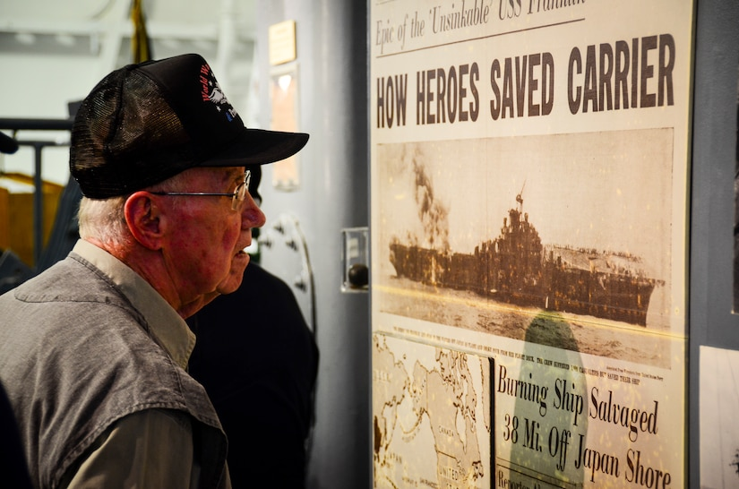 A World War II veteran reads a newspaper posted in the USS Franklin (CV 13) exhibit aboard the USS Yorktown (CV 10) May 17, 2013, at Patriots Point Naval and Maritime Museum, Mount Pleasant, S.C. More than 20 of the remaining crewmembers of the Franklin gathered for a final reunion. In their honor, Patriots Point hosted a series of events and educational programs throughout the day to allow the public an opportunity to speak with and hear from the veterans. (U.S. Air Force photo/Staff Sgt. Anthony Hyatt)