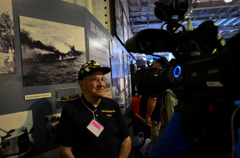 Harold Rausch, who served on the USS Franklin (CV 13), answers questions during an interview May 17, 2013, aboard the USS Yorktown (CV 10) at Patriots Point Naval and Maritime Museum, Mount Pleasant, S.C. More than 20 of the remaining crewmembers of the Franklin gathered for a final reunion. In honor of the historic event, Patriots Point hosted a series of events and educational programs throughout the day to allow the public an opportunity to speak with and hear from the veterans. (U.S. Air Force photo/Staff Sgt. Anthony Hyatt)