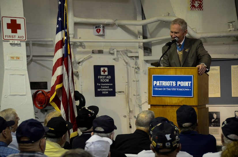 Retired U.S. Marine Corps Maj. Gen. Jim Livingston talks about the crewmembers of USS Franklin (CV 13) during a memorial service May 17, 2013, aboard the USS Yorktown (CV 10) at Patriots Point Naval and Maritime Museum, Mount Pleasant, S.C. In honor of the historic reunion, Patriots Point hosted a series of events and educational programs throughout the day to allow the public an opportunity to speak with and hear from the veterans. (U.S. Air Force photo/Staff Sgt. Anthony Hyatt)