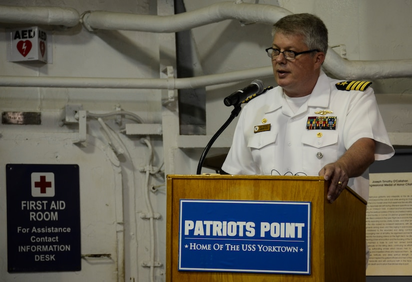 Navy Capt. Thomas Bailey, Joint Base Charleston deputy commander, speaks about the USS Franklin (CV 13) mission during a memorial service May 17, 2013, aboard the USS Yorktown (CV 10) at Patriots Point Naval and Maritime Museum, Mount Pleasant, S.C. In honor of the historic reunion, Patriots Point hosted a series of events and educational programs throughout the day to allow the public an opportunity to speak with and hear from the veterans. (U.S. Air Force photo/Staff Sgt. Anthony Hyatt)