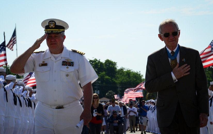 Navy Capt. Thomas Bailey, Joint Base Charleston deputy commander, and retired U.S. Marine Corps Maj. Gen. Jim Livingston, walk down the pier toward the USS Yorktown (CV 10) May 17, 2013, at Patriots Point Naval and Maritime Museum, Mount Pleasant, S.C., as surviving crewmembers of the USS Franklin (CV-13), gathered at Patriots Point for their final reunion. In honor of the historic event, Patriots Point hosted a series of events and educational programs throughout the day to allow the public an opportunity to speak with and hear from veterans. More than 20 remaining crewmembers of the Franklin attended the reunion. (U.S. Air Force photo/Staff Sgt. Anthony Hyatt)