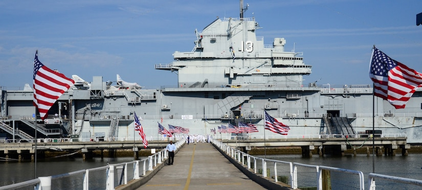 The number 13 is displayed on the USS Yorktown's (CV-10) island in honor of the USS Franklin (CV-13), as the surviving crewmembers gather for their final reunion May 17, 2013, at Patriots Point Naval and Maritime Museum, Mount Pleasant, S.C. The Franklin participated in Pacific Theater operations during World War II and was in service from 1944 to 1945. The ship is best known for the March 19, 1945 attack, when two Japanese bombs struck the ship. The Franklin earned the designation as the most heavily damaged U.S. aircraft carrier to survive World War II and the ship and crew remain the most decorated in U.S. Navy history – earning two Medals of Honor, 19 Navy Crosses, 22 Silver Stars and 1,100 Purple Hearts. (U.S. Air Force photo/Staff Sgt. Anthony Hyatt)