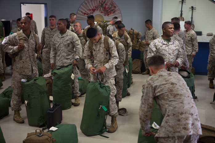 Marines with 2nd Battalion, 4th Marines, 5th Marine Regiment, 1st Marine Division, have their gear inspected at customs following their arrival here, May 22. The Marines of 2/4 arrived in Okinawa to become the 31st Marine Expeditionary Unit's new battalion landing team, replacing 1st Battalion, 5th Marine Regiment, after their six-month tour with the MEU. The 31st MEU is the only continuously forward-deployed MEU and is the Marine Corps' force in readiness in the Asia-Pacific region.
