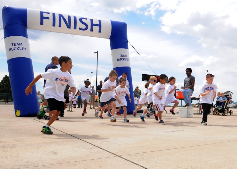 Military children begin their 1-mile run May 18, 2013, at the youth center on Buckley Air Force Base Colo. The Armed Forces Kids Run is an Air Force wide event during which parents and children can participate together. (U.S. Air Force photo by Senior Airman Marcy Glass/Released)