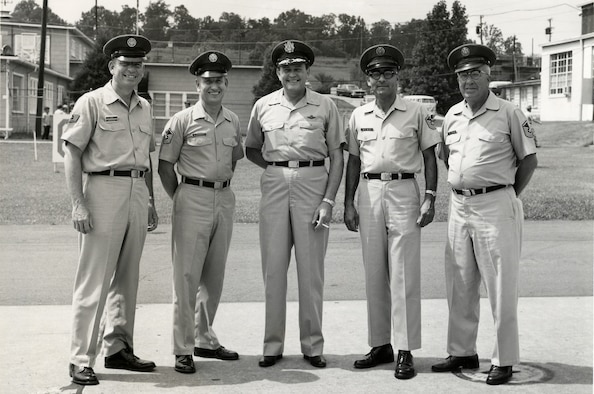 MCGHEE TYSON AIR NATIONAL GUARD BASE, Tenn. – The first instructors of the Air National Guard Noncommissioned Officers Academy in 1968 get their photo taken with U.S. Air Force Maj. Gen. I.G. Brown, then Director of the Air National Guard. From left, U.S. Air Force Tech. Sgt. Sheridan J. Lloyd, Senior Master Sgt. Robert Alexander, Maj. Gen. I.G. Brown, Senior Master Sgt. Joseph Diaz and Senior Master Sgt. Donald Pettirew at their ranks shown. NCO Academy was the I.G. Brown Training and Education Center's first program of instruction. The TEC was later dedicated to Brown during its 10th anniversary celebration, June 1978. (U.S. Air National Guard file-photo/Released)