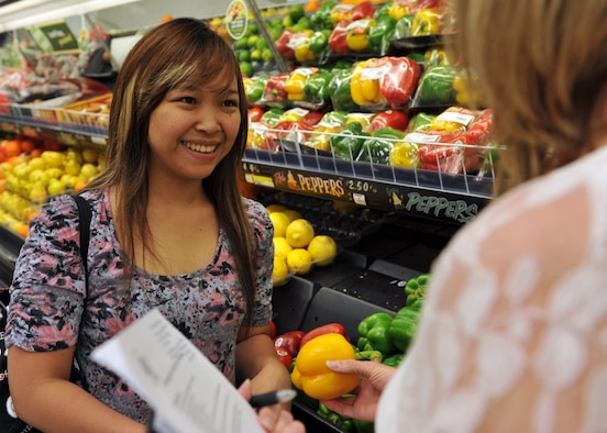 Aissa Lodwick, wife of Staff Sgt. Brett Lodwick, 509th Munitions Squadron munitions systems craftsman, learns about the benefits of eating fresh vegetables during a commissary tour at Whiteman Air Force Base, May 10, 2013. During the tour, a 509th Medical Operations Squadron community dietitian teaches consumers how to make healthier food selections while grocery shopping. (U.S. Air Force photo by Heidi Hunt/Released)