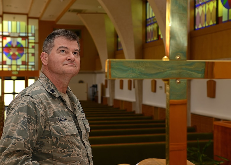 Chaplain (Lt. Col.) John Tillery, reflects on his faith at the Aviano Air Base Chapel in Italy May 15, 2013. Discovering faith helped Tillery recover from a very violent and chaotic upbringing.  (U.S. Air Force photo/Staff Sgt. Ryan Whitney)