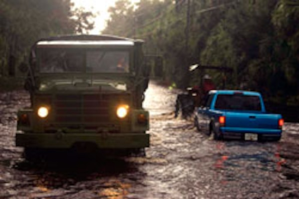 Members of the 2nd Battalion, 124th Infantry Regiment driving a high-water vehicle search flooded roads and properties for people needing assistance or evacuation. The Florida National Guard assisted civilian agencies with nearly 500 Soldiers and Airmen supporting logistical operations and high-water vehicle rescues across central and northern Florida after recent storms.
