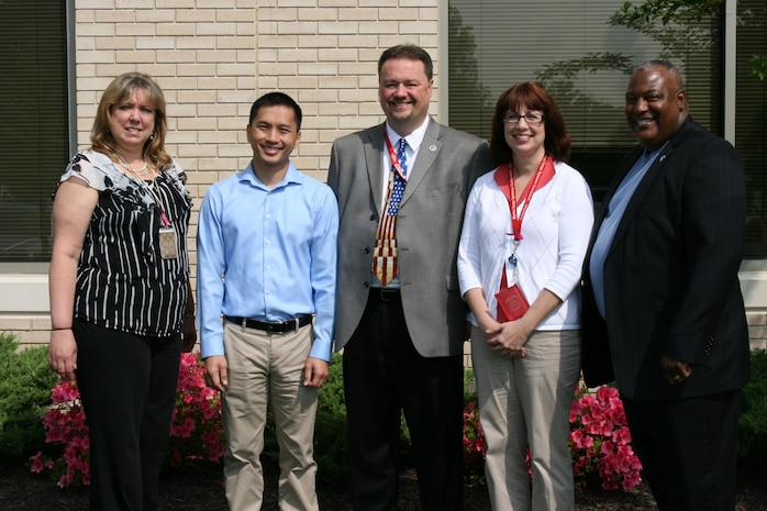 """Marine Corps Systems Command and Program Executive Officer Land Systems have won the 2012 Department of the Navy Acquisition Excellence Award for Small Business Team. Led by Dave Dawson (center), associate director of Small Business Programs, team members included (from left) Jodie Shifflett, contracting officer; Dung """"Zoom"""" Phan, lead engineer; Judy Campbell, contract specialist; and Austin """"A.J."""" Johnson, Small Business Program deputy. Not pictured are Patrick Garrard, program analyst, and Lenore Boissiere, project officer."""