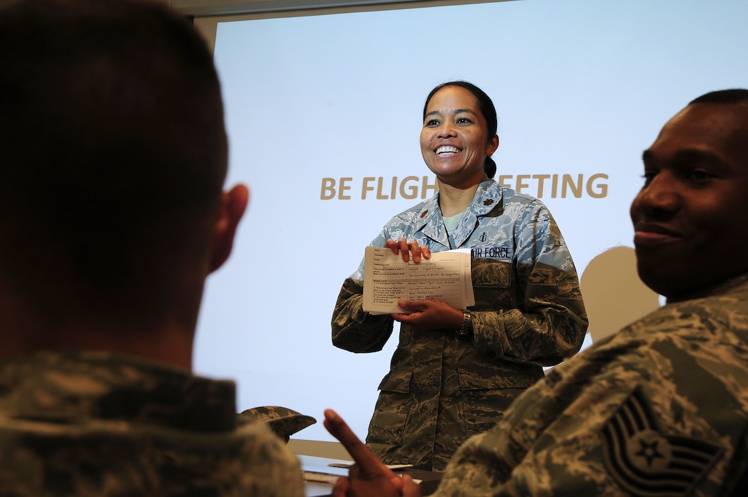 Maj. Elisa Hammer, 779th Aeromedical Squadron Bioenvironmental Engineering flight chief, conducts a flight meeting May 3, 2013, at Joint Base Andrews, Md. ?There is never a dull moment in bioenvironmental engineering and it is an honor to serve alongside these bright Airmen,? Hammer said. (U.S. Air Force photo by Senior Airman Steele C. G. Britton)