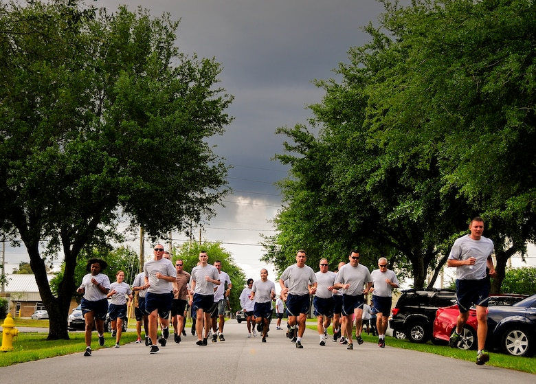 Almost 50 Airmen ran out for the 5K race at Duke Field, Fla.  Also part of the run were stations that Airmen had to stop at and perform calisthenics.  (U.S. Air Force photo/Tech. Sgt. Samuel King Jr.)