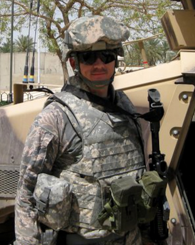 U.S. Air Force Staff Sgt. Michael Sibbett, 366th Medical Group technician, stands in front of an armored military vehicle after completing a mission to the International Zone in Iraq, 2011. Sibbett has deployed twice, each time earning valuable medical experience in the process. (Courtesy photo)