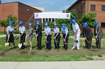 Leadership from across the National Capital Region break ground together for the 79th Medical Wing?s new Malcolm Grow Medical Clinic and Surgery Center and the Joint Base Andrews Dental Clinic, May 22, 2013, at JBA, Md. The eco-friendly certified ?green? multi-story building will encompass more than 300,000 square feet and will be home to an ambulatory care and surgery center, emergent care center, physical and occupational therapy, family health facilities and space for specialty clinics and other ancillary services. (U.S. Air Force photo by Senior Airman Steele C. G. Britton)