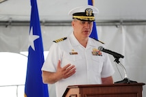 U.S. Navy Capt Kenneth Branch, Naval Facilities Engineering Command Commanding officer speaks to those in attendance of a groundbreaking ceremony for the 79th Medical Wing?s new Malcolm Grow Medical Clinic and Surgery Center and the Joint Base Andrews Dental Clinic, May 22, 2013, at JBA, Md. Branch, who is the lead officer for the MGMCSC building contract, shared his personal tie and positive experience at the clinic when his wife gave birth to their daughter more than twenty years ago at the facility that stands on JBA today. (U.S. Air Force photo by Senior Airman Steele C. G. Britton)