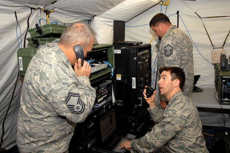 U.S. Air Force Senior Master Sgt. Greg Stevens, 1st Lt. Michael Wingrave, and Master Sgt. Chad Valentine work in the Joint Incident Site Communications Capability (JISCC) during the Ardent Sentry exercise in West Columbia May 19, 2013. The S.C. National Guard is participating in a major NORAD and USNORTHCOM sponsored training exercise called Ardent Sentry, May 17-21, 2013.  It involves a scenario of a hurricane striking the South Carolina coast, requiring more than 1,500 members of the S.C. National Guard to practice disaster response activities and coordination procedures.  (U.S. Air National Guard photo by Lt. Col. Jim St. Clair/Released)