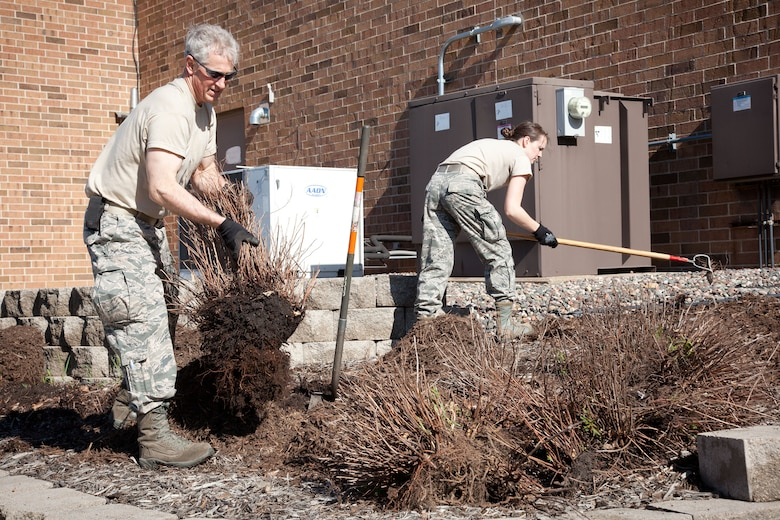 Members of the 934th Airlift Wing do some spring sprucing up during the annual Base Clean up Day at the Minneapolis-St. Paul Air Reserve Station, Minn.  (U.S. Air Force photo/Shannon McKay)