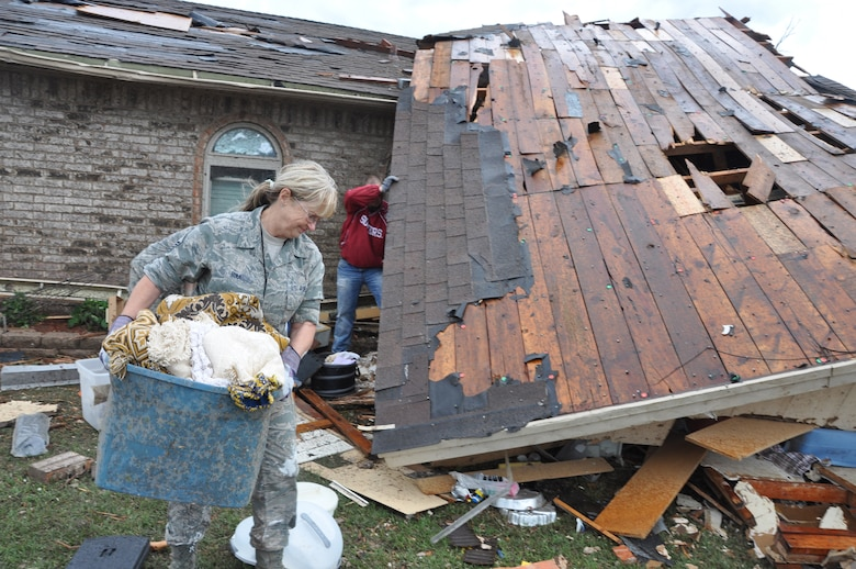 Air Force Master Sgt. Cherry Bina, Oklahoma Air National Guard, 137th Maintenance Group, recovers personal items from her own house in Moore, Okla., May 21, 2013. Her house was severely damaged after a devastating tornado killed dozens of people in Moore, Okla., May 20, 2013. (U.S. Air Force photo by Maj. Jon Quinlan)