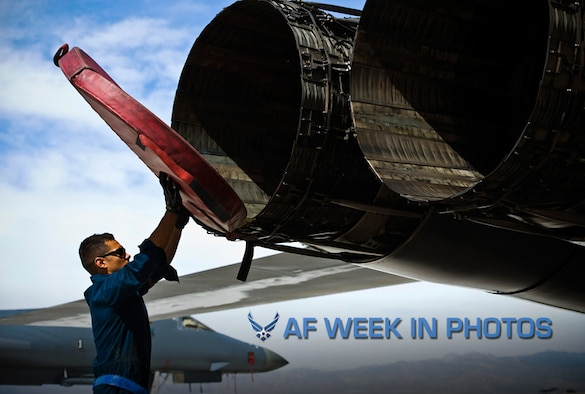 Staff Sgt. Kevin Colon removes exhaust covers from a B-1B Lancer during a Green Flag exercise May 21, 2013, at Nellis Air Force Base, Nev. Green Flag-West provides a realistic close-air support training environment for forces preparing to support worldwide combat operations. Colon is a 7th Aircraft Maintenance Squadron crew chief from Dyess Air Force Base, Texas. (U.S. Air Force photo/Airman 1st Class Christopher Tam)