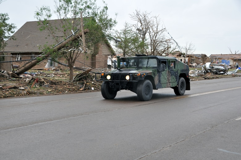 Members of the Oklahoma National Guard drive down Telephone Road preparing to get into the neighborhoods devastated by the massive tornado that struck Moore Okla., on May 20, 2013.  (U.S. Air Force photo by Senior Airman Mark Hybers)