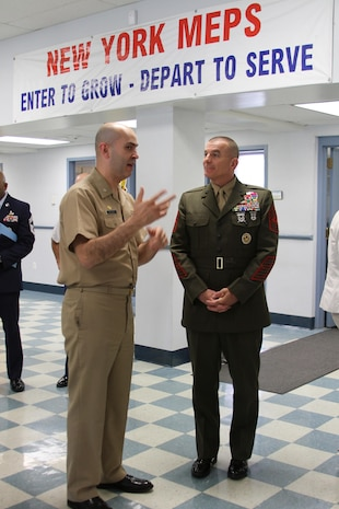 Sgt. Maj. Bryan B. Battaglia, the Senior Enlisted Advisor to Chairman of the Joint Chiefs of Staff, speaks with Cmdr. Jose G. Hernandez, 2nd Battalion commander, before administering the oath of enlistment to a group of applicants at the Military Entrance Processing Station at Fort Hamilton in Brooklyn, N.Y., May 21.  Battaglia visited MEPS while in New York to tour the facility and administer the oath of enlistment to more than 25 military applicants.