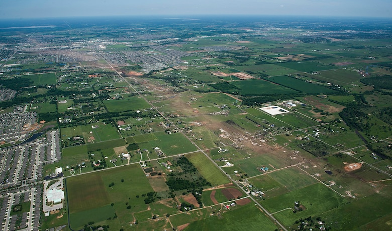 The path of a recent tornado in Moore, Okla., May 22, 2013. A tornado categorized as an EF5, the strongest category possible, with winds ranging from 200 to 210 mph struck Moore May 20, 2013. The Oklahoma Office of the Chief Medical Examiner reports 24 fatalities related to the storm. (U.S. Air Force photo/Tech. Sgt. Bradley C. Church)