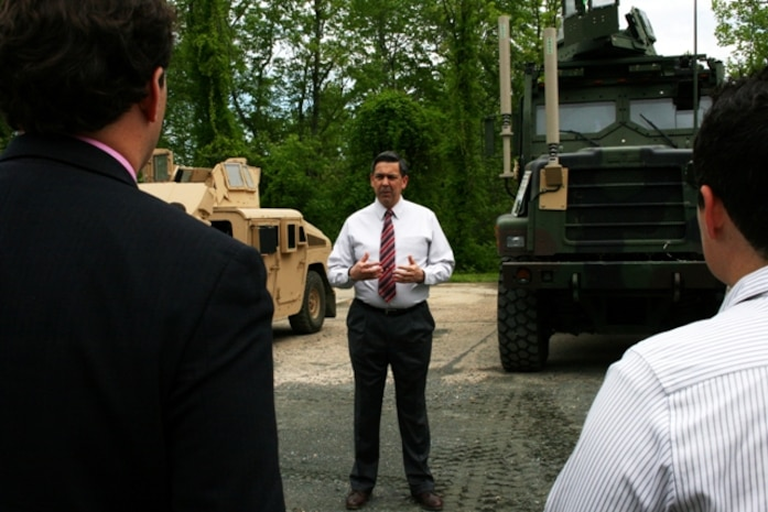 """Ruben Garza, Transportation Demonstration Support Area manager,  a TDSA overview briefing to members of the Small Business Administration and Marines participating in the """"Boots to Business"""" program during a visit May 9 in Quantico, Va. The group visited TDSA to view static displays of several Marine Corps vehicle platforms."""