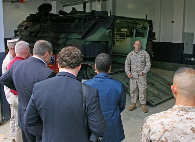 "Gunnery Sgt. Kevin Wallace, subject matter expert with the Program Management Office for Advanced Amphibious Assault, talks to a group of visitors about the Assault Amphibious Vehicle at the Transportation Demonstration Support Area May 9 in Quantico, Va. Members of the Small Business Administration and Marines participating in the ""Boots to Business"" program visited TDSA to view static displays of several Marine Corps vehicle platforms."