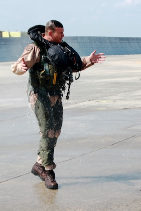 Col. Michael Cederholm, the commanding officer of Marine Aircraft Group 31, is sprayed down with water in celebration of his final flight as the commanding officer of MAG-31 aboard Marine Corps Air Station Beaufort, May 17. Cederholm relinquished command of MAG-31 to Col. William Lieblein during a change of command ceremony, May 20.