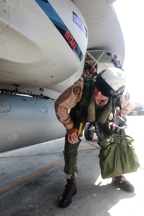 Col. Michael Cederholm, the commading officer of Marine Aircraft Group 31, performs a preoperational inspection on an F/A-18 Hornet prior to his last flight as the commanding officer of MAG-31 aboard the Marine Corps Air Station Beaufort flight line, May 17. Cederholm relinquished command of MAG-31 to Col. William Lieblein during a change of command ceremony, May 20.
