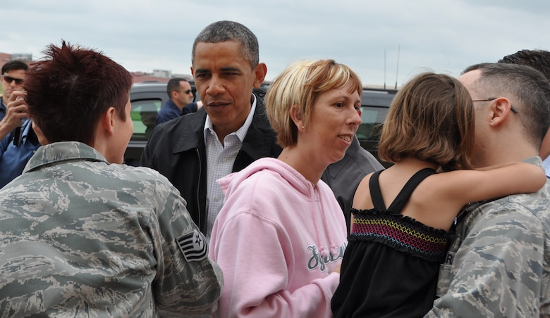 President Barack Obama greets reserve Tech Sgt. Lindsay Newton, 507th Maintenance Squadron at Tinker Air Force Base, May 26. The president landed at Tinker Air Force Base on his way to Moore, Okla. to survey the tornado devastation and meet with victims and first responders. Tinker employees that were personally affected by the May 20 tornado and base first responders got the opportunity to meet the president. (U.S. Air Force photo/Maj. Jon Quinlan)