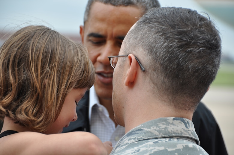 TINKER AIR FORCE BASE, Okla.--President Barack Obama greets Capt. Russell Ramsey and the family affected by the tornado here, May 26. Team Tinker members effected by the EF-5 Tornado that hit Moore Okla. and first responders, met with the president on the flight line before he traveled to Moore to see the devastation first hand.  (U.S. Air Force Photo by Maj. Jon Quinlan)