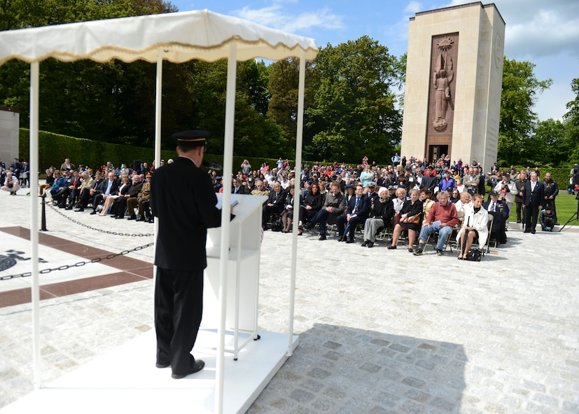LUXEMBOURG – People listen to opening remarks during a Memorial Day commemoration at the Luxembourg American Military Cemetery and Memorial May 25, 2013. The cemetery contains the remains of more than 5,000 American service members, most who died during the Battle of the Bulge fought nearby. (U.S. Air Force photo by Airman 1st Class Gustavo Castillo/Released)