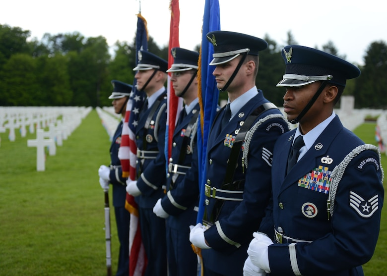 LUXEMBOURG – Members of the Spangdahlem honor guard stand in formation during a Memorial Day commemoration at the Luxembourg American Military Cemetery and Memorial May 25, 2013. As part of the formation, the Airmen posted and presented the flags during a 21-gun salute and the playing of taps to mark the end of the ceremony. (U.S. Air Force photo by Airman 1st Class Gustavo Castillo/Released)