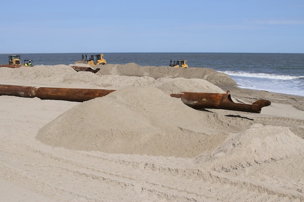 WALLOPS ISLAND, Va. – Pipes strewn along the newly built beach at NASA's Wallops Island Flight Facility here carry sand pumped from dredges offshore. The new beach will help protect more than $1 billion in federal government and Commonwealth of Virginia assets located here.  The Wallops Island facility is home to, not only NASA, but also the US Navy Surface Combat Systems Center and the Mid-Atlantic Regional Spaceport making this a growing economic generator for the Commonwealth of Virginia and the region.