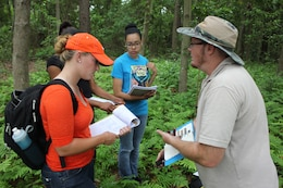 Bill Rutlin, a regulatory specialist with the U.S. Army Corps of Engineers, helps students identify soils during a field exercise at Savannah State University.