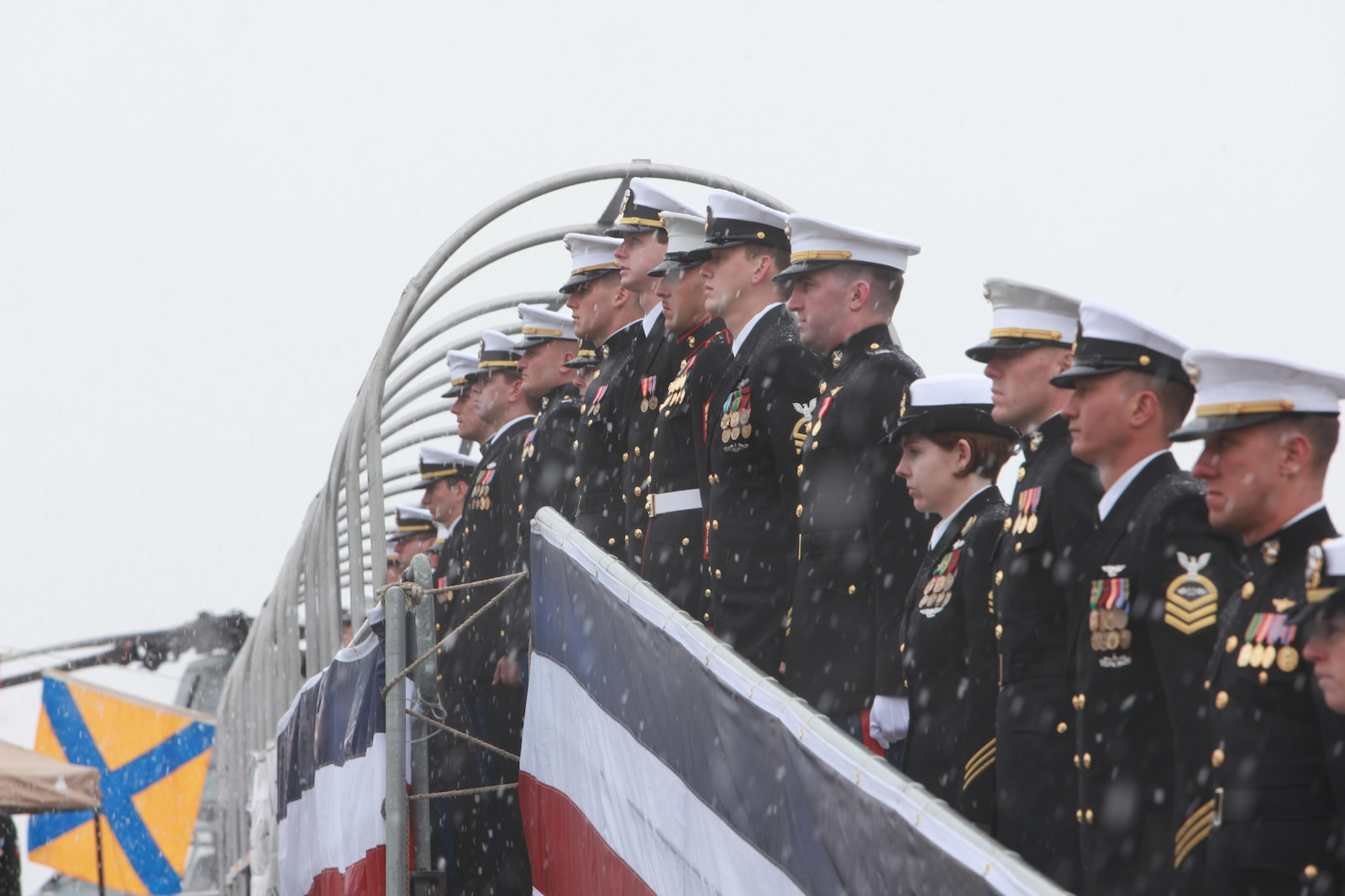 Marines with Task Force Denali man the rails during the USS Anchorage commissioning ceremony in Anchorage, Alaska, May 4, 2013. More than 4,000 people gathered to witness the ceremony. The USS Anchorage is the second ship to be named after the city and the first U.S. Navy ship to be commissioned in Alaska.
