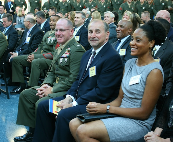 (Left to right) Lt. Col. Robert Emminger, deputy program manager for Ammunition at Marine Corps Systems Command; Jerry Mazza, program manager for Ammunition; and Gunnery Sgt. Tasha Johnson, staff noncommissioned officer in charge of the Inventory Management Team in PM Ammo, attend the 2012 Ammunition Awards Program Reception May 22 at the National Museum of the Marine Corps in Triangle, Va. The awards are named in honor of Johnson's husband, Gunnery Sgt. Edwin Johnson, an ammunition technician who was killed in action in Afghanistan in 2009.