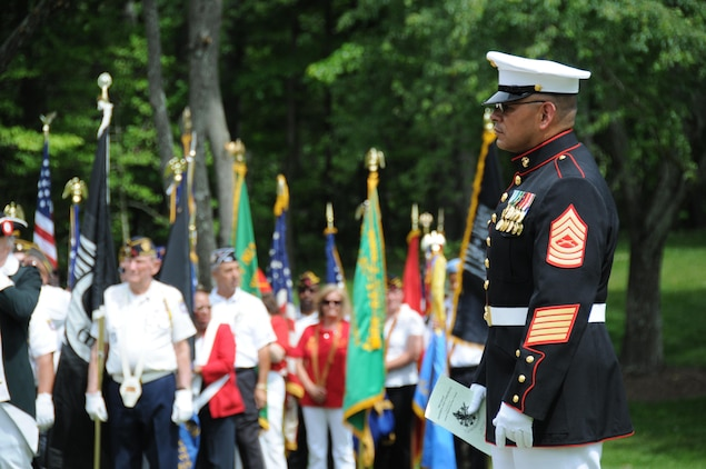 Master Sgt. J.S. Santoya, Marine Corps Base Quantico operations chief, oversees the formation of troops prior to the Potomac Region Veterans Council Memorial Day Ceremony held at Quantico National Cemetery on May 27, 2013.The event has been held for 30 years, paying homage fallen service members.