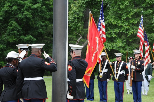 Marine Corps Base Quantico ceremonial platoon Marines salute during the national anthem at the start of the Potomac Region Veterans Council Memorial Day Ceremony was held at Quantico National Cemetery on May 27, 2013. The event has been held for 30 years, paying homage fallen service members.