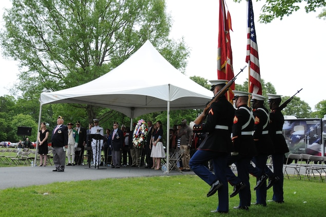 The Marine Corps Base Quantico color guard move to position after marching on the colors during the Potomac Region Veterans Council Memorial Day Ceremony was held at Quantico National Cemetery on May 27, 2013.  The event has been held for 30 years, paying homage fallen service members.