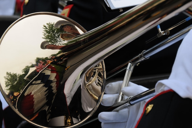 "A trombonist with the Quantico Marine Band plays ""God Bless America"" during the Potomac Region Veterans Council Memorial Day Ceremony held at Quantico National Cemetery on May 27, 2013. The day, originally called Decoration Day, is a day of remembrance for those who have died in service to our nation."