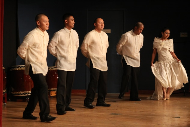 Members of the Filipino American society perform the Filipino folk dance of Maria Clara during the 2013 Asian American/Pacific Islander Heritage Awareness Month celebration at the Club Iwakuni ball room May 22, 2013. The celebration helped to bolster the appreciation and understanding of the numerous Asian and Polynesian cultures which contribute to American society.