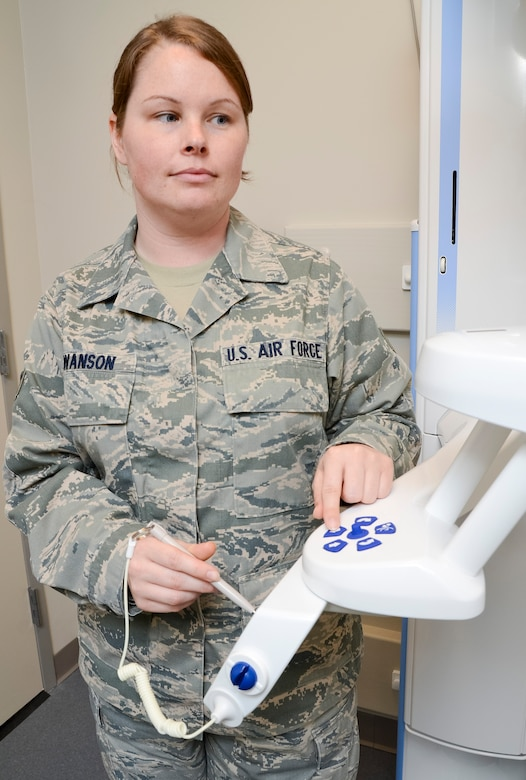 U.S. Air Force Senior Airman Meghan Swanson, a dental technician with the 116th Air Control Wing, Georgia Air National Guard (ANG), adjusts settings on a Planmeca Promax imaging unit in preparation to give dental x-rays at Robins Air Force Base, Ga., May 2, 2013.  Swanson works in the 116th Medical Group as a full-time dual-status civil service employee whose position is tied to an ANG military position.  (U.S. Air National Guard photo by Master Sgt. Roger Parsons/Released)