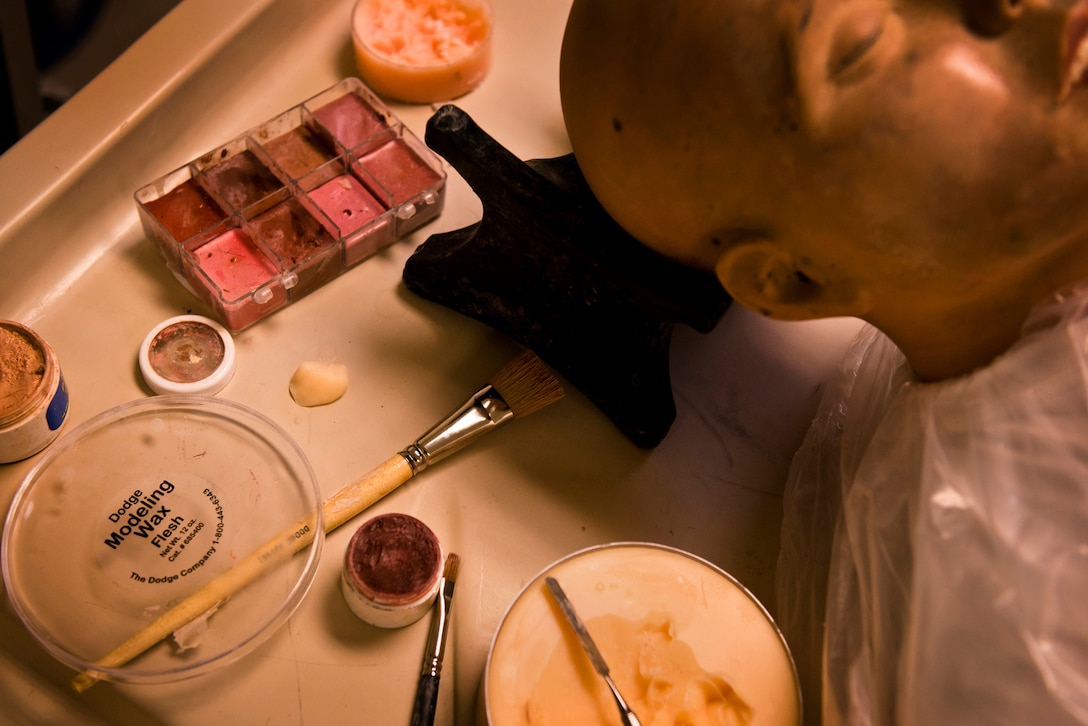 Along with dressing remains, Mable Justice also molds features and applies makeup to remains that are unrecognizable when they come through the Air Force Mortuary Affairs Office at Dover Air Force Base, Del. (U.S. Air Force photo/Senior Airman Andrew Lee/)
