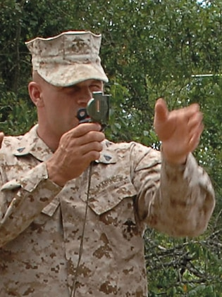 A Marine demonstrates the correct use of a compass during land navigation training at the Corporals' Course held aboard Marine Corps Logistics Base Albany, May 12-24.
