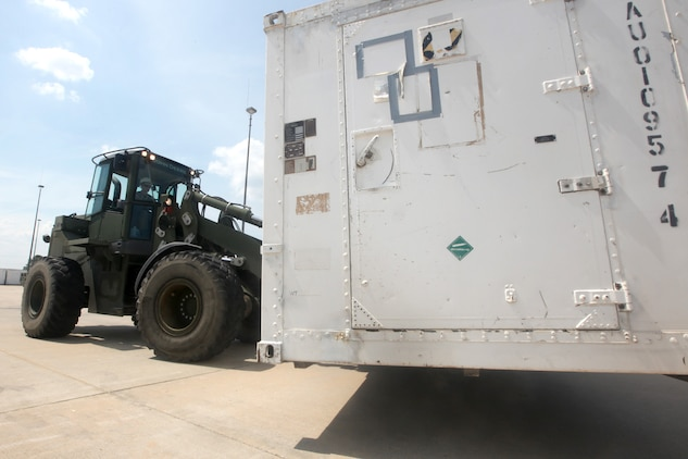 A 624KR Tractor, Rubber Tired, Articulated Steering, Multi-purpose vehicle is used to lift and transport mobile facilities with Marine Aviation Logistics Squadron 31 during a rearrangement of the facilities aboard Marine Corps Air Station Beaufort, May 17. Marines worked diligently over a three-day-span to rearrange between 150 and 200 mobile facilities after a power analysis determined the new positioning would benefit the work centers and Marines.
