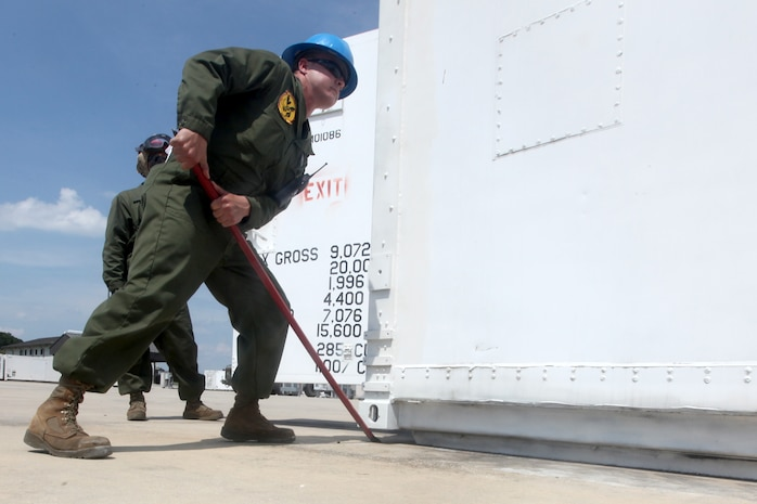 Staff Sgt. Dennis Heil, the assistant staff noncommissioned officer in charge, mobile facility work center, Marine Aviation Logistics Squadron 31, adjusts a mobile work facility for properly alignment during a rearrangement of the facilities aboard Marine Corps Air Station Beaufort, May 17. Heil along with other Marines of the mobile facility work center, rearranged between 150 - 200 mobile facilities in a three-day span.