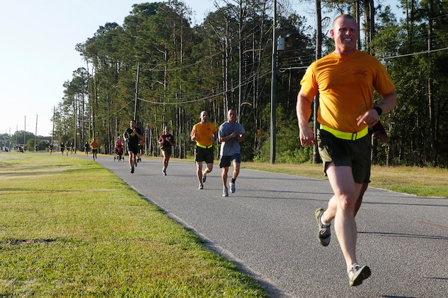 Participants in the 2nd Quarterly Road Race run towards the finish line aboard Marine Corps Recruit Depot Parris Island, May 22. The road race was a total of 4 miles; medals were awarded to the top finishers based on age.